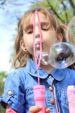 Girl with bubbles Stock Photos
