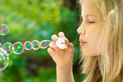 Girl and bubbles Stock Image