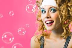 Girl with bubbles Stock Photos