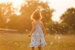 Girl and bubbles Stock Photos