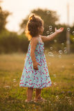 Girl and bubbles Royalty Free Stock Photography