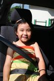 Girl buckle seatbelt. Little girl buckle up seatbelt sitting in the car Stock Images