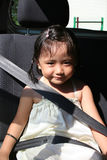 Girl buckle seatbelt. Little girl buckle up seatbelt sitting in the car Stock Photo