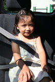 Girl buckle seatbelt. Little girl buckle up seat-belt sitting in the car Stock Image