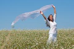 Girl in buckwheat Royalty Free Stock Photos
