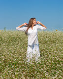 Girl in buckwheat Royalty Free Stock Image