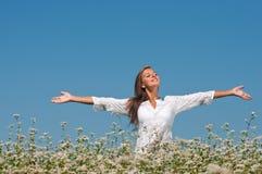 Girl in buckwheat Royalty Free Stock Photo