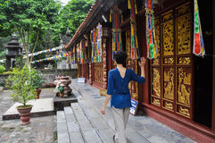 Girl in a Buddhist pagoda Stock Images