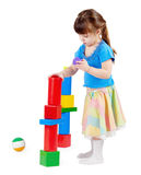 Girl build a tower of toy bricks Royalty Free Stock Image