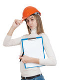 Girl builder. With a protective helmet and tablet Stock Photos