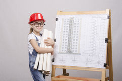Girl Builder costs with drawings at Board Stock Photo