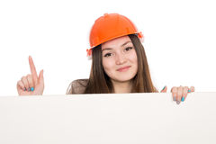 Girl builder in helmet showing thumbs up with blank banner. Royalty Free Stock Images