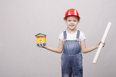 Girl Builder keeps house and drawing Stock Photography