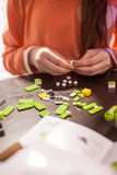 Girl building blocks of the toy. Girl building blocks of the green toy royalty free stock images