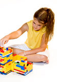 Girl is building house Royalty Free Stock Image