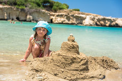 Girl building sand castle. Little girl building sand castle Royalty Free Stock Photos