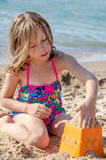 Girl building sand castles Royalty Free Stock Images