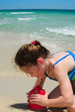 Girl building sandcastle on beach Royalty Free Stock Image