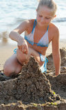 The girl builds sand castle Royalty Free Stock Photo