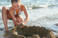 The girl builds sand castle Royalty Free Stock Photography