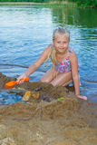 Girl builds a sand castle Stock Image