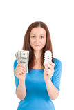 Girl with bulb and money Royalty Free Stock Photography