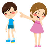 Girl Bullying Boy. Evil little girl bullying poor sad boy kid pointing finger laughing and mocking Stock Photos