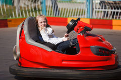 Girl in a bumper car. Teenage girl sleeping in a bumper car Stock Images