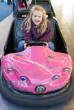 Girl in bumper car Stock Photography