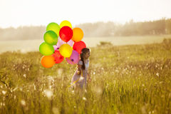 Girl with a bunch of balloons Royalty Free Stock Photography