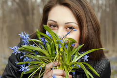 A girl with bunch of bluebells. In spring forest Royalty Free Stock Photos
