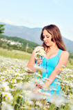 Girl with bunch of daisies Royalty Free Stock Images