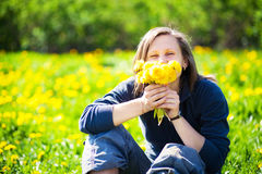 Girl with bunch of dandelions Royalty Free Stock Photography