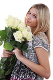 Girl with bunch of flowers Royalty Free Stock Photos