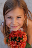 Girl with bunch of flowers Stock Photography