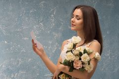 Girl with bunch of flowers Royalty Free Stock Images