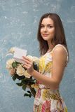 Girl with bunch of flowers Royalty Free Stock Photography