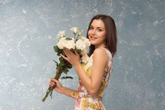 Girl with bunch of flowers Royalty Free Stock Photo