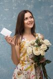 Girl with bunch of flowers Royalty Free Stock Image