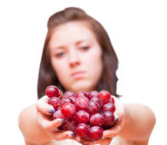 Girl and a bunch of grapes Royalty Free Stock Image
