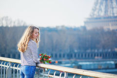 Girl with bunch of red tulips near the Eiffel tower Royalty Free Stock Image