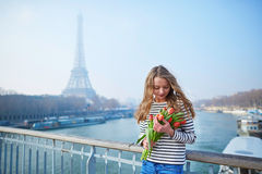 Girl with bunch of red tulips near the Eiffel tower Stock Image