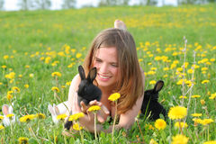 Girl with bunnies Royalty Free Stock Image