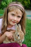 Girl with bunny Stock Images