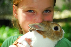 Girl with bunny. Portrait of a young girl holding a bunny outside Stock Photos