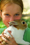 Girl with a bunny Stock Images
