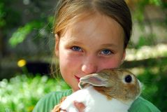 Girl and bunny Stock Photos