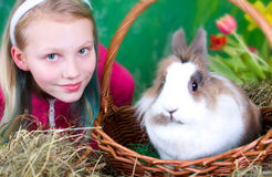 Girl with bunny in basket Royalty Free Stock Photos