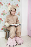 Girl In Bunny Costume And Monster Slippers Reading Stock Photography