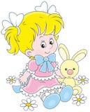 Girl and Bunny Stock Image